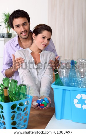 Young couple recycling - stock photo