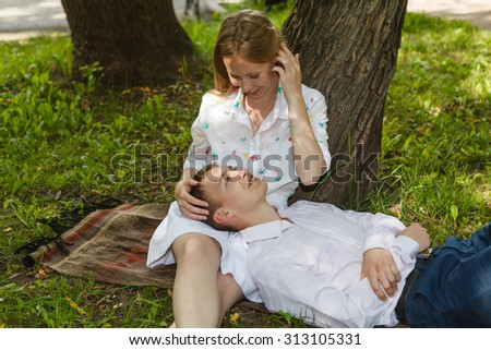 Young couple relaxed in park. Love story. - stock photo