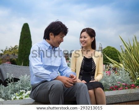 Young couple relaxing and chatting in the park