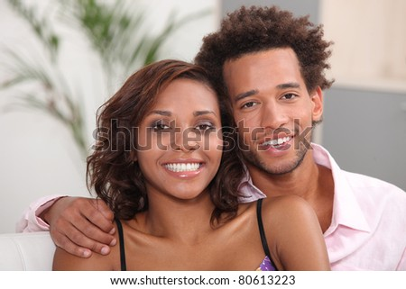 Young couple relaxing at home - stock photo