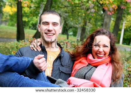 young couple relaxing in autumn park
