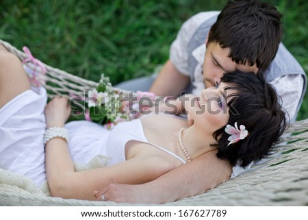 young couple Relaxing In spring Hammock - stock photo