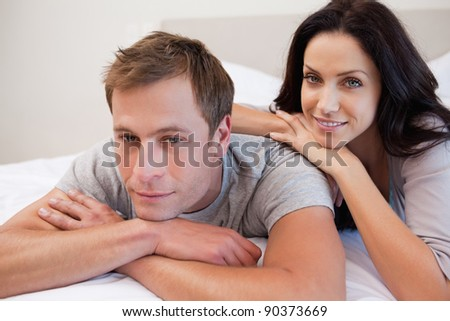 Young couple relaxing in the bedroom together