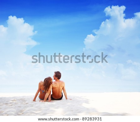 Young couple relaxing on a tropical resort