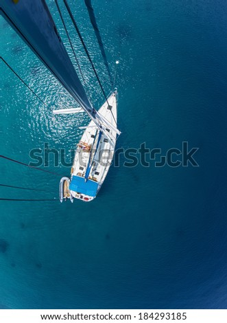 Young couple relaxing on board of the sail boat anchored in shallow tropical bay - stock photo