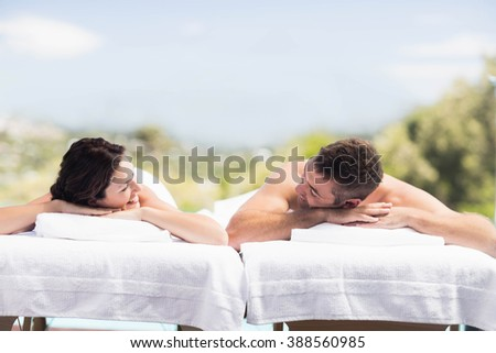 Young couple relaxing on massage table in spa - stock photo