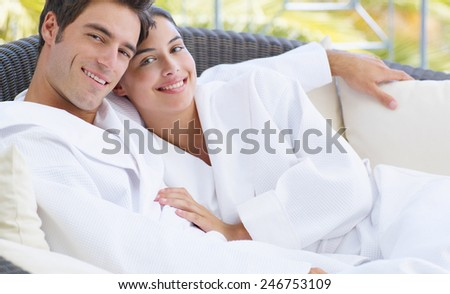 Young Couple Relaxing under a Beach Canopy - stock photo