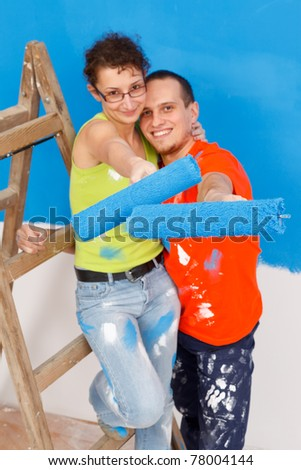 Young couple renovating their new home together