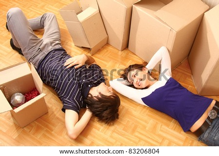 Young couple resting from moving into a new home. - stock photo
