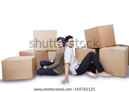Young couple resting from moving into a new home. isolated on white