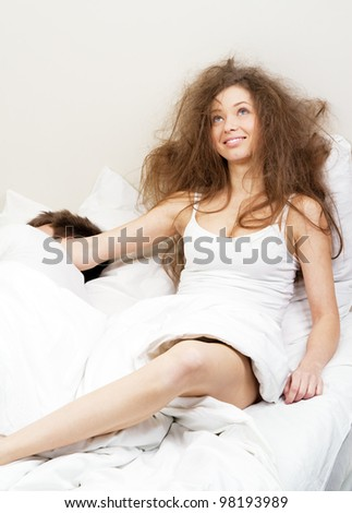 Young couple resting in bed - stock photo