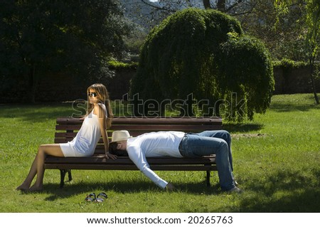Young couple resting on a bench