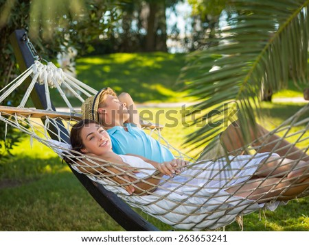 Young couple resting on hammock - stock photo