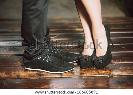 young couple's legs - stock photo