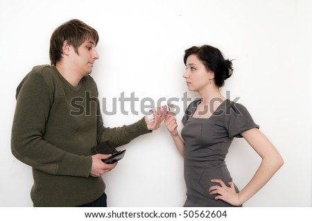 Young Couple Scene, he give her money - stock photo