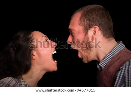 young couple screaming at each other - stock photo