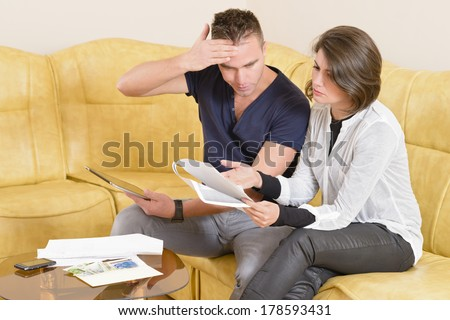 Young couple setting the budget - stock photo