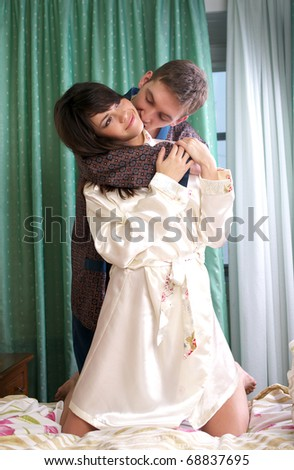 Young couple sharing a passionate moment together - stock photo