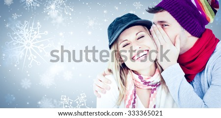 Young couple sharing a secret against snowflake pattern - stock photo
