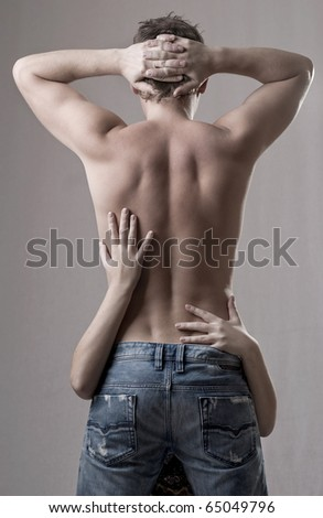 Young couple sharing a tender moment - stock photo