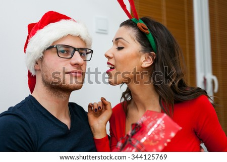 Young couple sharing gifts. Christmas time