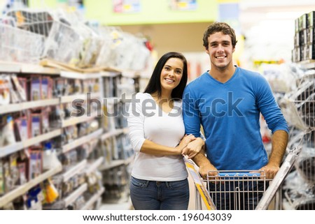 young couple shopping at hardware store - stock photo