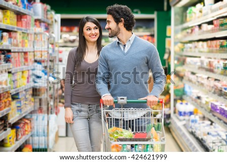 Young couple shopping in a grocery store - stock photo
