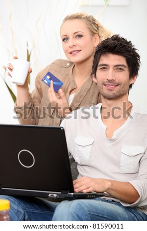 young couple shopping online - stock photo