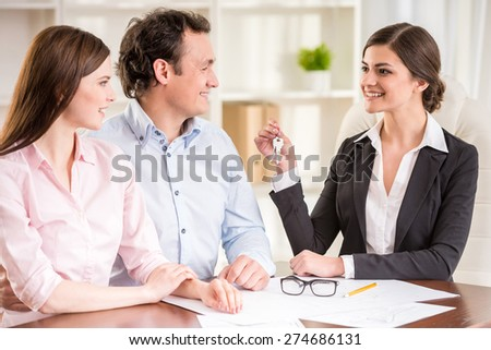 Young couple signed financial contract with female realtor. - stock photo