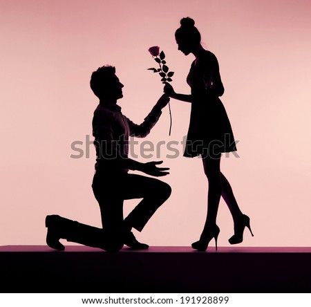 Young couple silhouettes - stock photo