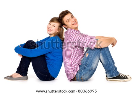Young couple sitting - stock photo