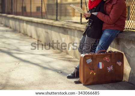 Young couple sitting and planning the trip - stock photo