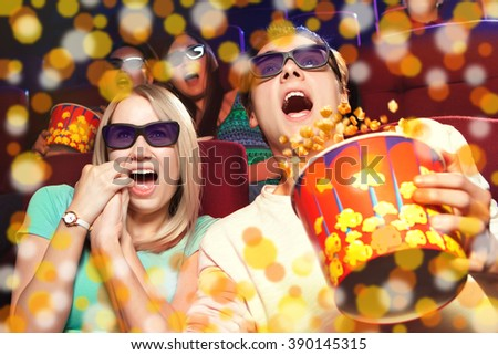 Young couple sitting at the cinema, watching a horrors film. Cinema photo series - stock photo