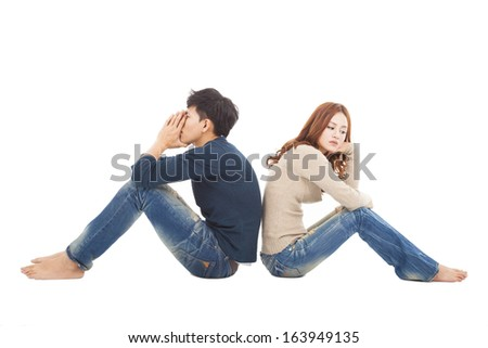 young Couple sitting back to back  during  conflict - stock photo