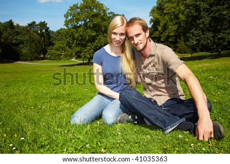 Young couple sitting outside in a park