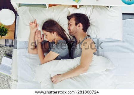 Young couple sleeping in bed under blanket. Young Couple Sleeping Bed Under Blanket Stock Photo 281800724