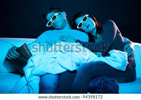 Young couple sleeping on a boring movie - stock photo