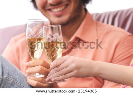 young couple smiling and drinking together