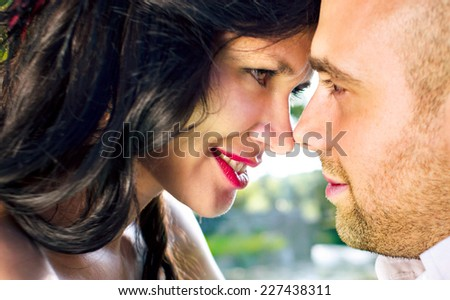 Young couple smiling and looking at each other - stock photo