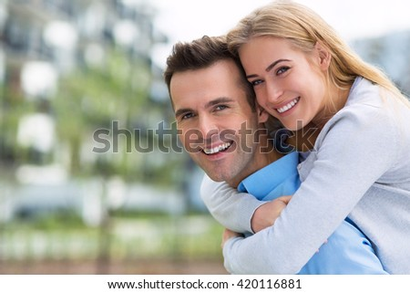 Young couple smiling outdoors  - stock photo