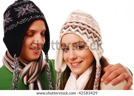 Young couple smiling together on white isolated background - stock photo