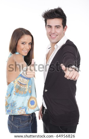young couple smiling with thumbs-up gesture isolated on white - stock photo