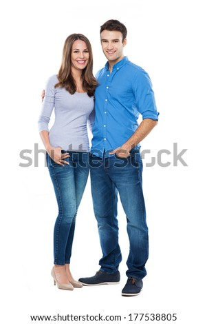 Young couple standing  - stock photo