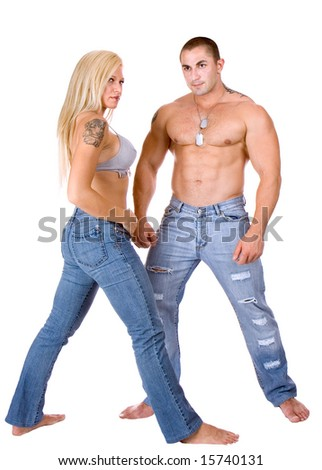 Young couple standing and posing - stock photo