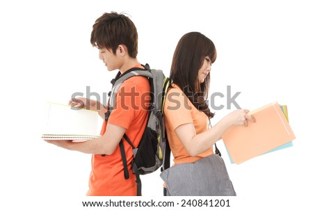 young couple standing back to back with notebooks - stock photo