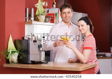 Young couple  standing in the kitchen - stock photo