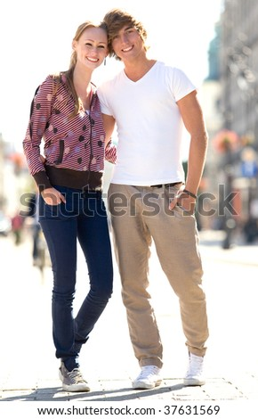 Young couple standing on street - stock photo