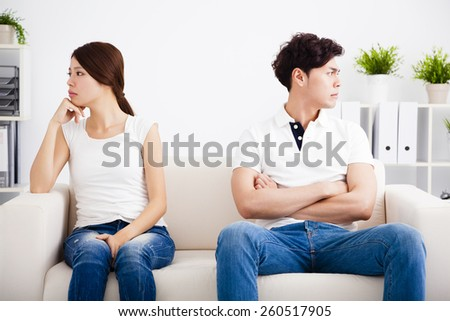 young Couple stress and  sitting on the sofa - stock photo