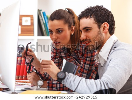 Young couple study together at home. - stock photo