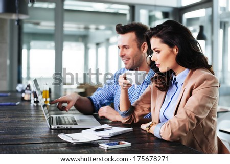 Young couple surfing the Internet on a laptop
